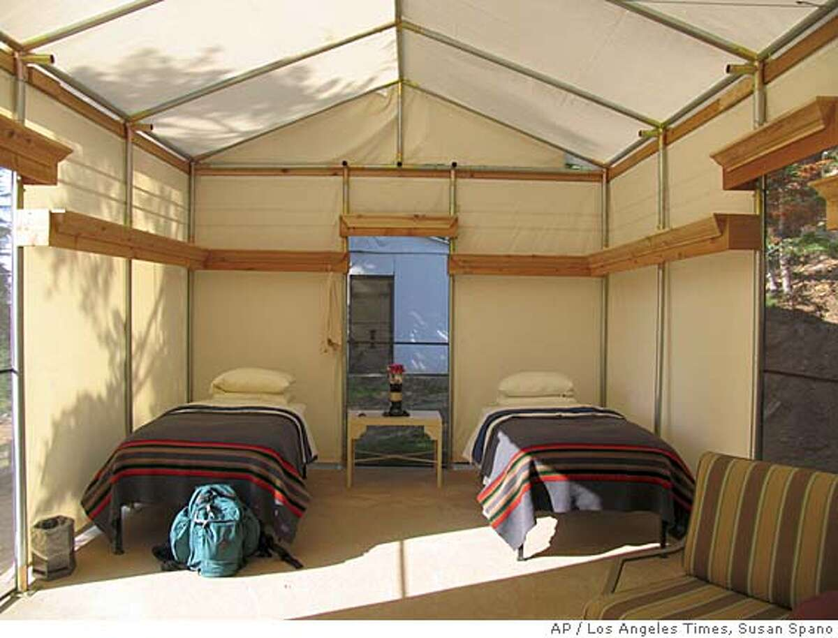 ** ADVANCE WEEKEND OCT 28-29 FILE ** Tents, each outfitted with plump beds, double sheeted and with Pendleton blankets for camping comfort, are seen Aug. 19, 2006, at Sequoia High Sierra Camp in Giant Sequoia National Monument. (AP Photo/Los Angeles Times, Susan Spano) ** MANDATORY CREDIT, MAGS OUT, NO SALES, NO FOREIGN **
