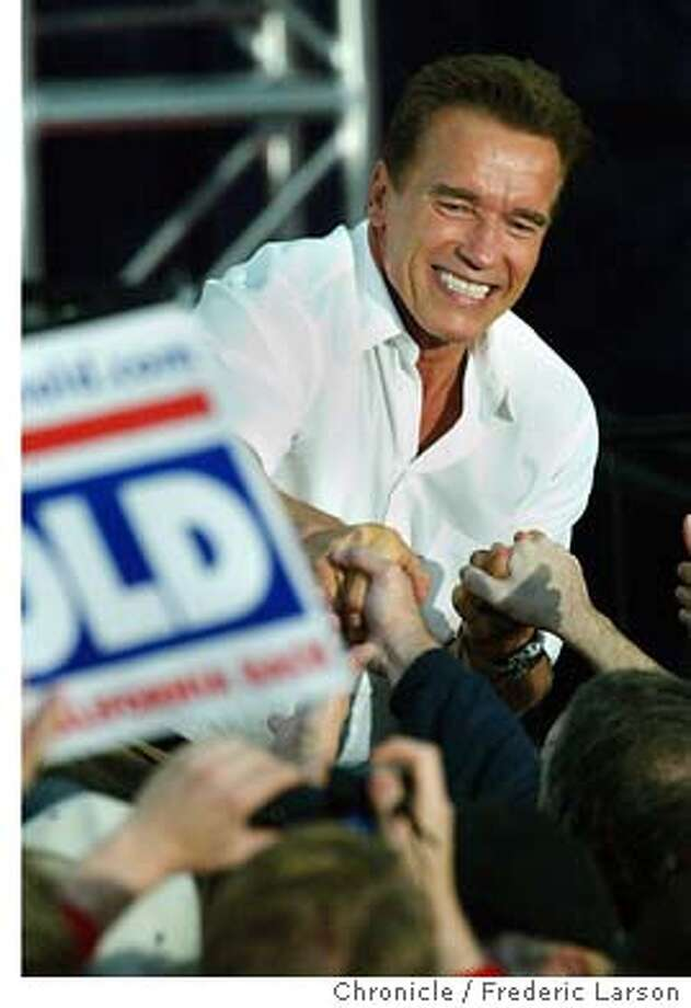 ; Arnold Schwarzenegger a recall candidate for California Governor, addresses republican supporters at a campaign rally at the Monterey Airport in Monterey.  City:� FREDERIC LARSON / The Chronicle Photo: FREDERIC LARSON
