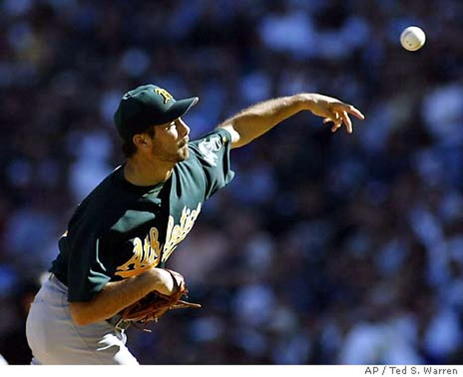 Oakland A's starting pitcher Ted Lilly throws against the Seattle Mariners in the second inning Sunday, Sept. 28, 2003 at Safeco Field in Seattle. (AP Photo/Ted S. Warren) Photo: TED S. WARREN