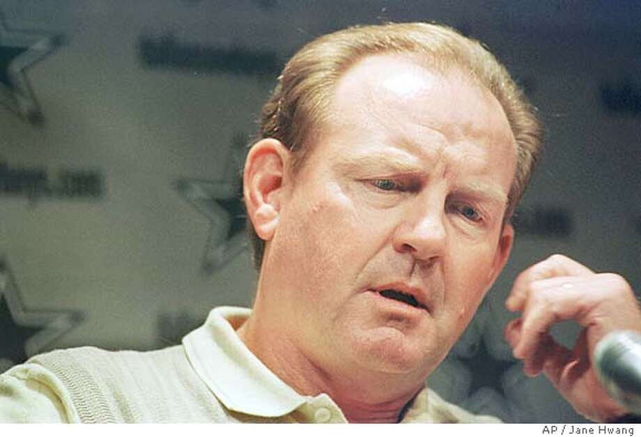 Fired Dallas Cowboys' coach Chan Gailey responds to reporters' questions during a news conference at the team's headquarters in Irving, Texas, Tuesday, Jan. 11, 2000. (AP Photo/Jane Hwang) CAT Photo: JANE HWANG