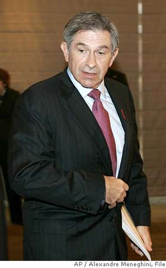 World Bank President Paul Wolfowitz arrives for a press conference in Sao Paulo, Brazil, on Tuesday, Dec. 20, 2005. Wolfowitz is in Brazil for a six-day official visit. (AP Photo/Alexandre Meneghini) BRAZIL OUT **EFE OUT** Photo: ALEXANDRE MENEGHINI