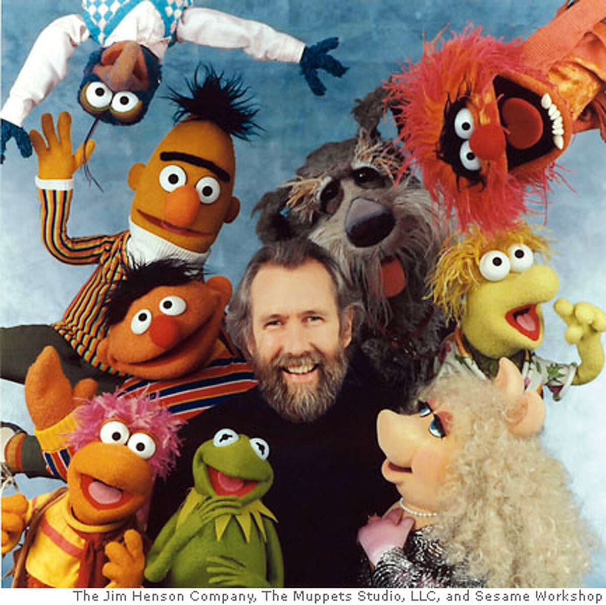 Jim Henson with various Muppet characters.