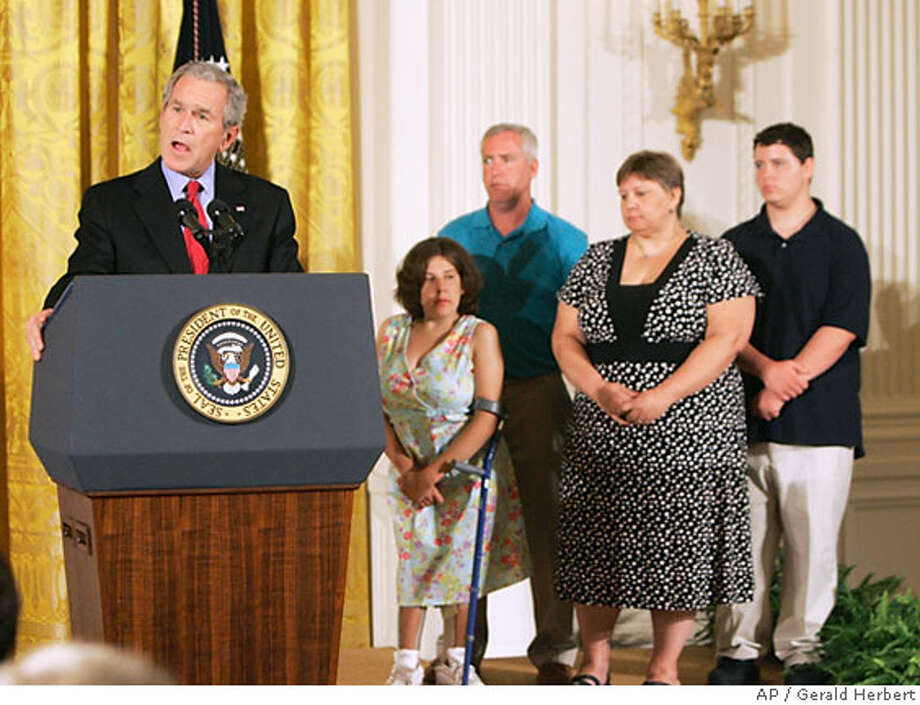 President Bush, left, accompanied by the McNamara family of Middletown, Conn., from second from left, spina bifida patient Kaitlyne McNamara, her parents Mike and Tracy McNamara, and brother Ian McNamara, right, makes remarks on stem cell research, Wednesday, June 20, 2007, in the East Room of the White House in Washington. (AP Photo/Gerald Herbert) Photo: Gerald Herbert