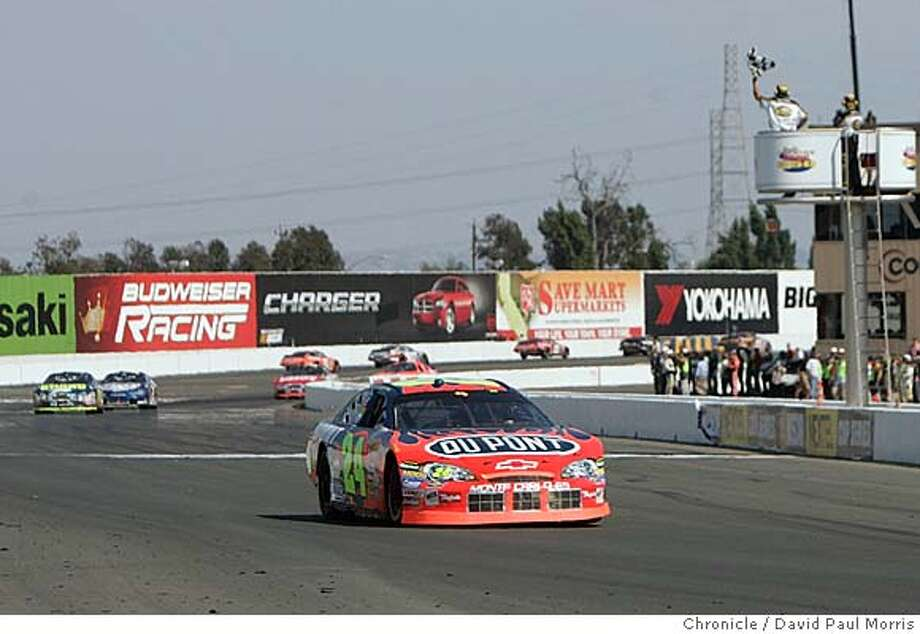 SONOMA, CA - JUNE 25: Jeff Gordon crosses the finish line in the Dodge/Save Mart 350 at the Infineon Raceway on June 25, 2006 in Sonoma, California. (Photo by David Paul Morris/The Chronicle)  Ran on: 06-21-2007  Jeff Gordon crosses the finish line to win the Dodge-Save Mart 350 last year at Infineon Raceway in Sonoma.  Ran on: 06-21-2007  Jeff Gordon crosses the finish line to win the Dodge-Save Mart 350 last year at Infineon Raceway in Sonoma. Photo: David Paul Morris