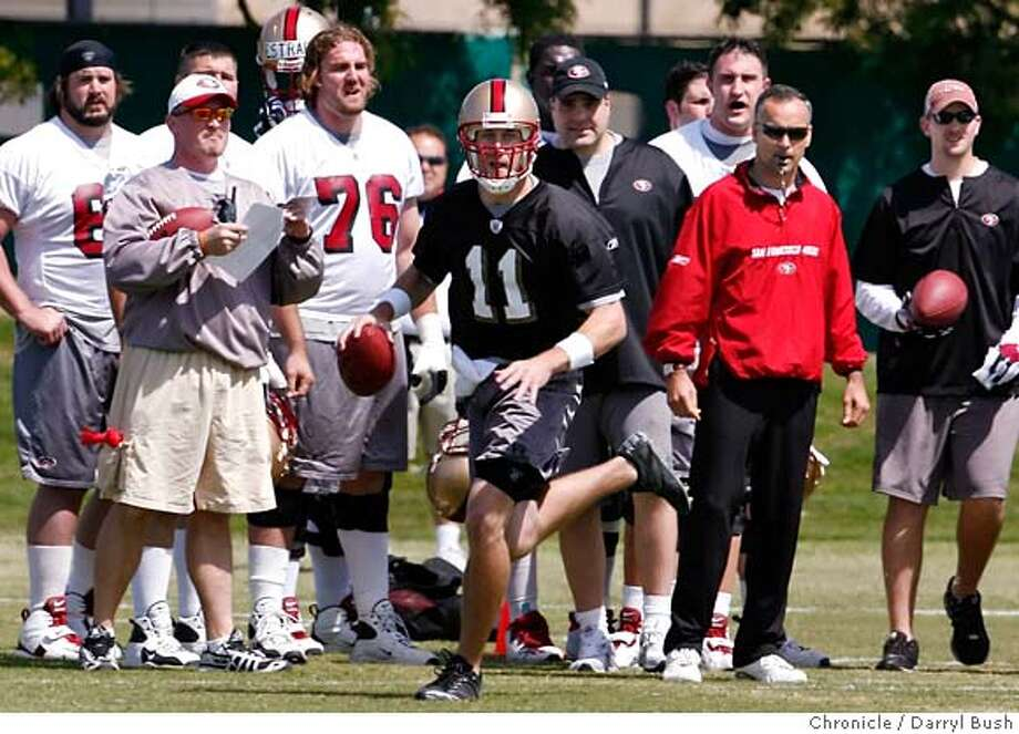 49ers_0004_db.JPG  49ers head coach Mike Nolan watches quarterback Alex Smith roll out during a scrimmage at 49ers mini-camp at their headquarters practice field in Santa Clara, CA, on Saturday, May, 5, 2007. photo taken: 5/5/07  Darryl Bush / The Chronicle ** roster (cq) MANDATORY CREDIT FOR PHOTOG AND SF CHRONICLE/NO SALES-MAGS OUT Photo: Darryl Bush