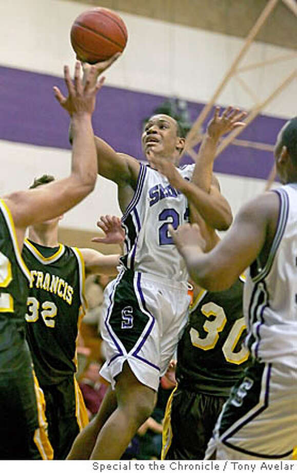 SLUG: Sequoia junior Dominic Stewart, center, shoots over a crowd of St. Francis players during a game at Sequoia High. Stweart is averaging 24 points per game this year for the Cherokees and is on pace to shatter the school's career scoring record. Photo by Tony Avelar. Photo: TONY AVELAR