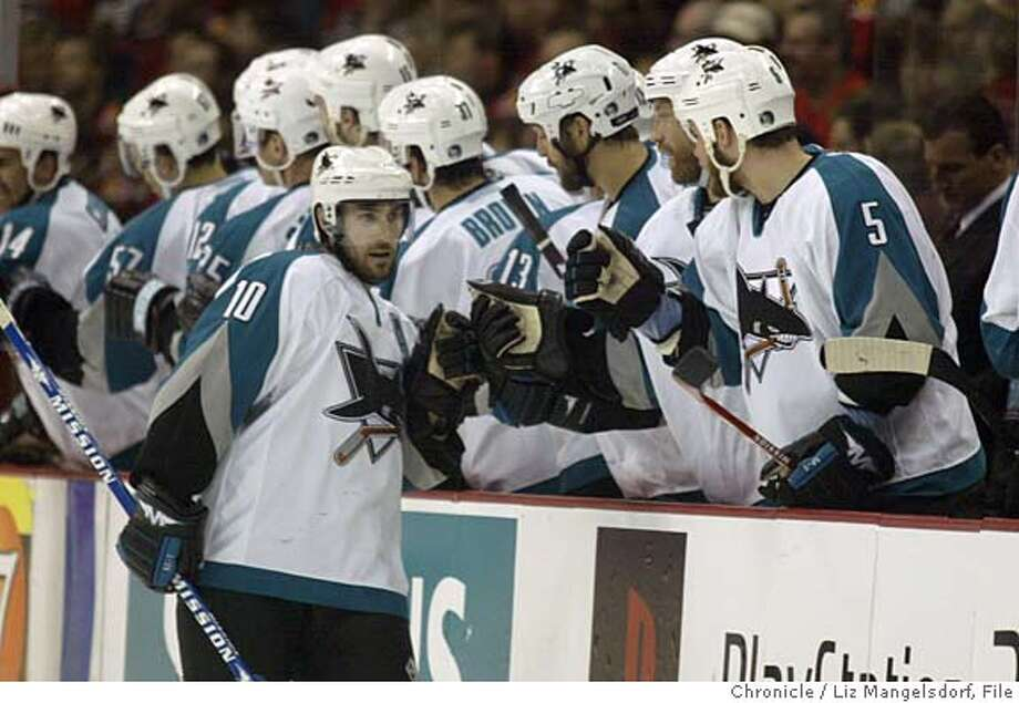 Event on 5/19/04 in Calgary.  Sharks #10 Alyn McCauley high fives the bench after scoring the sharks first goal in the 2nd period. San Jose Sharks play the Calgary Flames in game 6 of the playoffs. 2nd period.  Liz Mangelsdorf / The Chronicle Photo: Liz Mangelsdorf