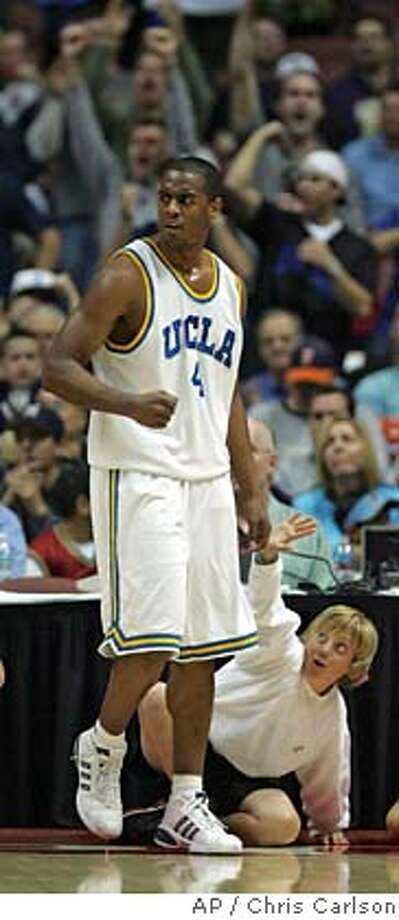 UCLA's Arron Afflalo celebrates a basket against Nevada in the first half of game two during the Wooden Classic basketball tournament Saturday, Dec. 10, 2005, in Anaheim, Calif. (AP Photo/Chris Carlson) Photo: CHRIS CARLSON