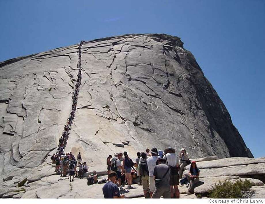 Photo of traffic jam of hikers trying to get up and down Half Dome on Saturday. Photo was taken 30 minutes before the fatal fall of Hirofumi Nohara. We have photogs permission to use Photo: Chris Lunny