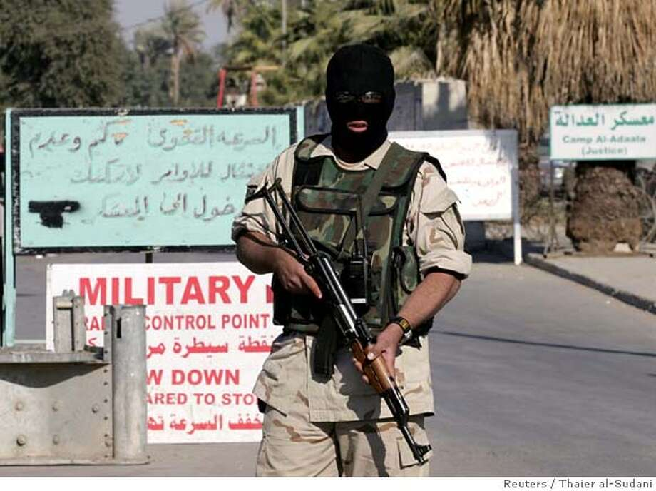 An Iraqi soldier stands guard at the gate of Camp Al Adaala prison in Kadhimiya district in Baghdad December 28, 2005. Iraqi police shot dead several prisoners in a shootout on Wednesday at a Baghdad military base after one prisoner grabbed a weapon from a guard and opened fire, Interior Ministry officials and police sources said. REUTERS/Thaier al-Sudani 0 Photo: THAIER AL-SUDANI