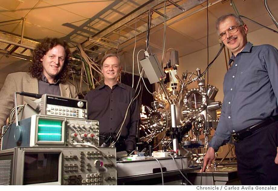 NANOTECH 01/C/07APR99/BU/CG --- This Hewlett Packard research team investigating the use of Nanotechnology to develop chips and computer components at the molecular level includes, from left to right, Jim Health, of UCLA, Stan Williams, center, and Phil Kuekes, right, of Hewlett Packard. The three researchers are standing with a Scanning Tunneling Microscope, which they use to measure their new components. (CHRONICLE PHOTO BY CARLOS AVILA GONZALEZ) ALSO RAN 01/31/03 CAT Photo: CARLOS AVILA GONZALEZ
