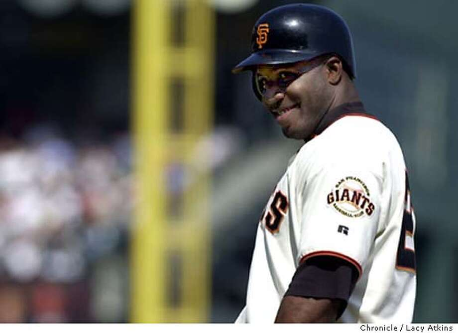 GIANTS046_la.jpg  SAN FRANCISCO GIANTS Barry Bonds teases with the LOS ANGELES DODGERS in the dugout after getting on first base SATURDAY, Sept. 27, 2003.  Lacy Atkins/Chronicle MANDATORY CREDIT FOR PHOTOG AND SF CHRONICLE/ -MAGS OUT Photo: Atkins, Lacy