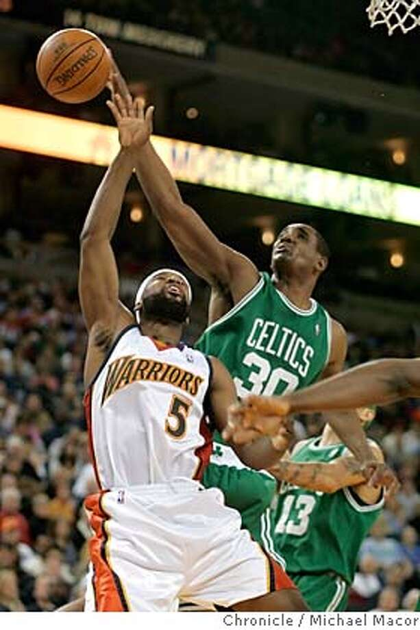 Warriors 5- Baron Davis battles Boston's 30-Mark Blount for a rebound. NBA Basketball. Golden State Warriors vs. Boston Celtics, at the Oakland Arena. Event in Oakland, Ca on 12/28/05. Photo by: Michael Macor / San Francisco Chronicle Photo: Michael Macor