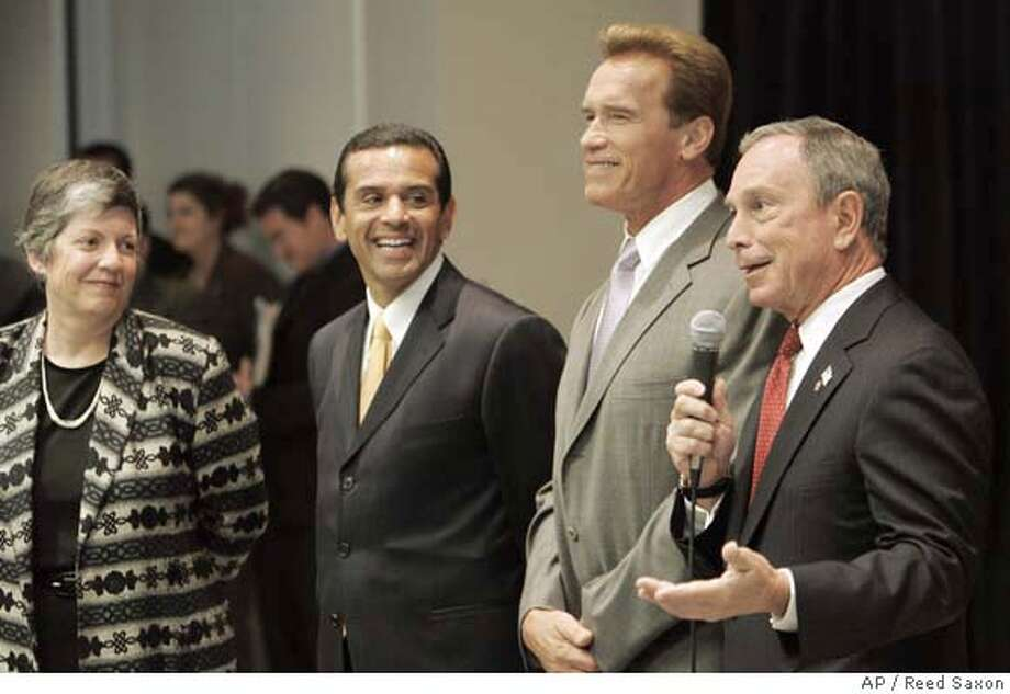 "From left, Arizona Gov. Janet Napolitano, Los Angeles Mayor Antonio Villaraigosa, California Gov. Arnold Schwarzenegger and New York City Mayor Michael Bloomberg face reporters following their participation at a conference, *Ceasefire! Bridging the Political Divide,"" focusing on local and state efforts to encourage bipartisanship and support common-sense solutions to the country*s most pressing political challenges, in Los Angeles Tuesday, June 19, 2007. The gathering is the inaugural conference of the newly established Center on Communication Leadership at the USC Annenberg School for Communication. (AP Photo/Reed Saxon) Photo: Reed Saxon"