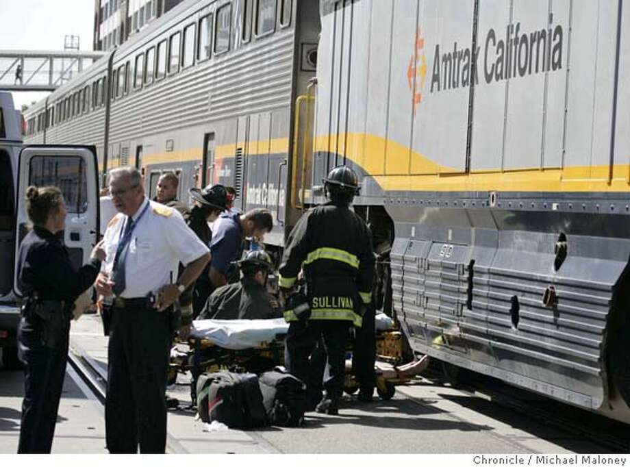 Rescue personnel tend to the woman struck by the Amtrack tarin.  A woman was struck by an Amtrack train this afternoon in front of Jack London Square on the Embarcadero at Broadway intersection in Oakland, CA on June 19, 2007. Photo by Michael Maloney / San Francisco Chronicle MANDATORY CREDIT FOR PHOTOG AND SF CHRONICLE/NO SALES-MAGS OUT Photo: Michael Maloney