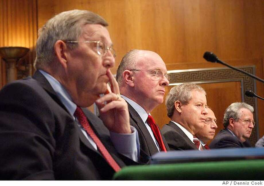 The heads of five major oil companies appear on Capitol Hill Wednesday, Nov. 9, 2005, to discusses energy pricing and profits before a joint hearing of the Senate Commerce and Energy and Natural Resources Committee. Left to right are Lee Raymond for Exxon Mobil, David O'Reilly of Chevron, James Mulva of Conoco Phillips, Ross Pillari of BP America and John Hofmeister of Shell. (AP Photo/Dennis Cook) Photo: DENNIS COOK