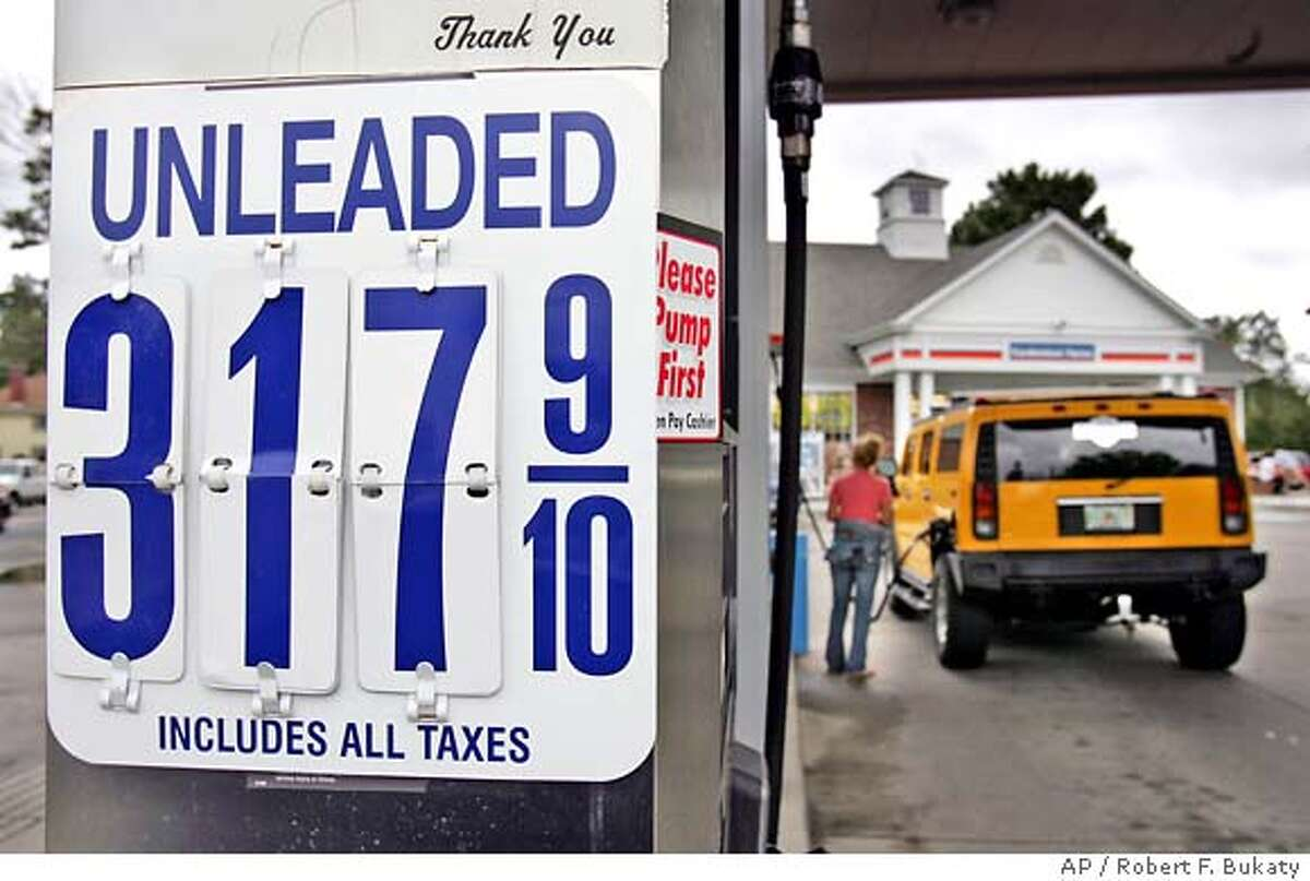 A motorist fills her Hummer with $3.17-per-gallon regular unleaded gas at a Cumberland Farms convenient store Wednesday, Aug. 31, 2005, in Gorham, Maine. (AP Photo/Robert F. Bukaty)