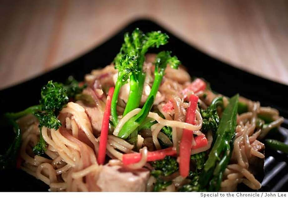 WORKING13_01_JOHNLEE.JPG  Ginger tofu with broccolini and noodles.  By JOHN LEE/SPECIAL TO THE CHRONICLE Photo: JOHN LEE