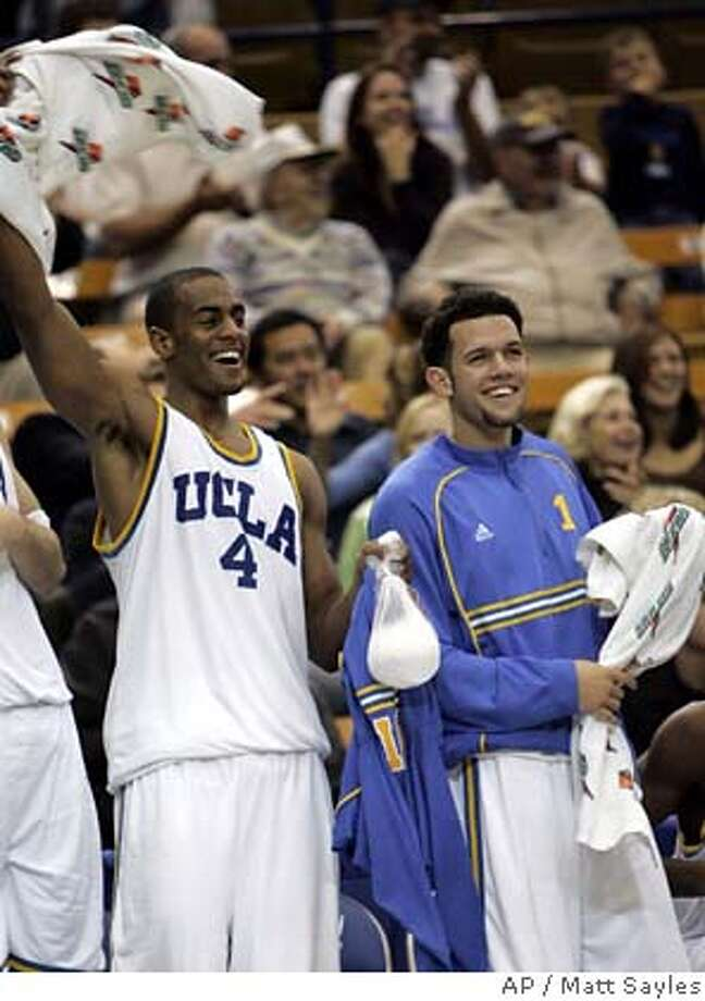 Number 12-ranked UCLA's Arron Afflalo, left, and Jordan Farmar celebrate during the second half of basketball action against Sacramento State in Los Angeles, on Friday, Dec. 23, 2005. Afflalo and Farmar led UCLA with 22 points and 15 points, respectively, and UCLA won, 86-56. (AP Photo/Matt Sayles) Photo: MATT SAYLES