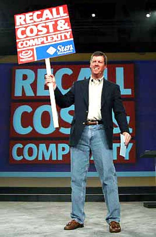 Scott McNealy, CEO of Sun Microsytems, holds up a sign to announce the launch of the Sun Java System, at the SunNetwork user conference, in San Francisco, Calif., Tuesday, Sept. 16, 2003. In a move aimed squarely at Microsoft Corp., Sun Microsystems Inc. unveiled Tuesday a suite of software for businesses that want to dump _ or just can't afford _ the Windows operating system on their companies' desktop computers. The Sun Java Desktop system, which was formerly code-named Mad Hatter, runs on the open-source Linux operating system and includes a variety of programs that replace Microsoft's Internet browser, productivity suite and other parts of the Windows package. (AP Photo/Sun Microsystems, Don Feria, HO) SUN MICROSYSTEMS HANDOUT PHOTO Photo: DON FERIA