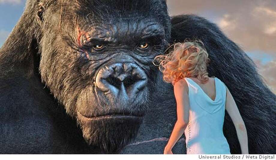 "An undated publicity photograph shows actress Naomi Watts, who portrays Ann Darrow sharing a quiet moment at sunrise with movie monster King Kong atop the Empire State Building, in a scene from the new film ""King Kong"" directed by triple Academy Award winner Peter Jackson. The film opens just after midnight on Wednesday and also stars Adrien Brody and Jack Black. NO ARCHIVES REUTERS/ Weta Digital Ltd./Universal Studios/Handout 0 Photo: HO"