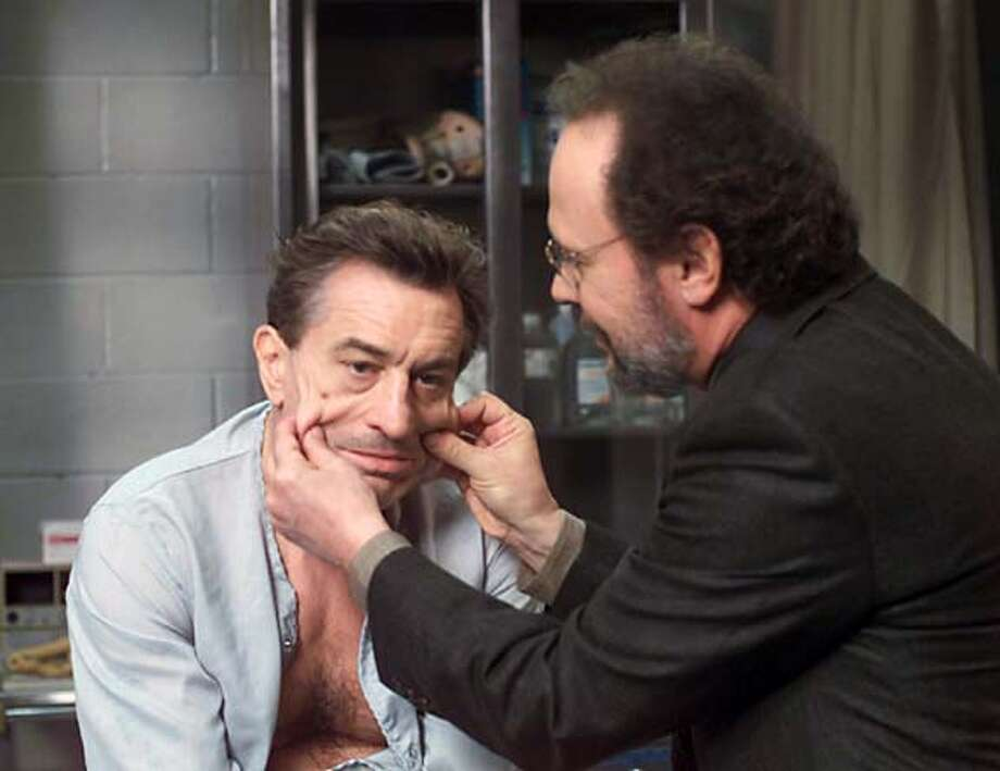 "Actors Billy Crystal (R) and Robert DeNiro are pictured in this undated publicity photograph in a scene from their new comedy film "" "" which opens December 6, 2002 in the United States. DeNiro portrays mob boss Paul Vitti who is nearing the end of his term in prison and uses his psychiatrist played by Crystal to help him get released from prison feigning mental problems. REUTERS/Warner Bros./Handout Photo: HO"