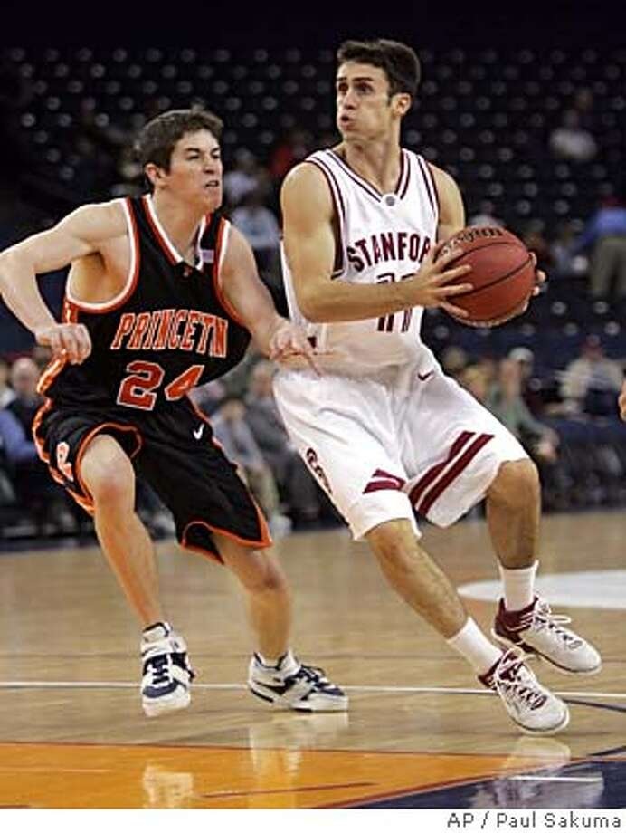 Stanford guard Chris Hernandez, right, drives to the basket in front of Princeton guard Kevin Steuerer (24) during the first half of a college basketball game in the Pete Newell Challenge, Wednesday, Dec. 21, 2005, in Oakland, Calif. (AP Photo/Paul Sakuma) Photo: PAUL SAKUMA