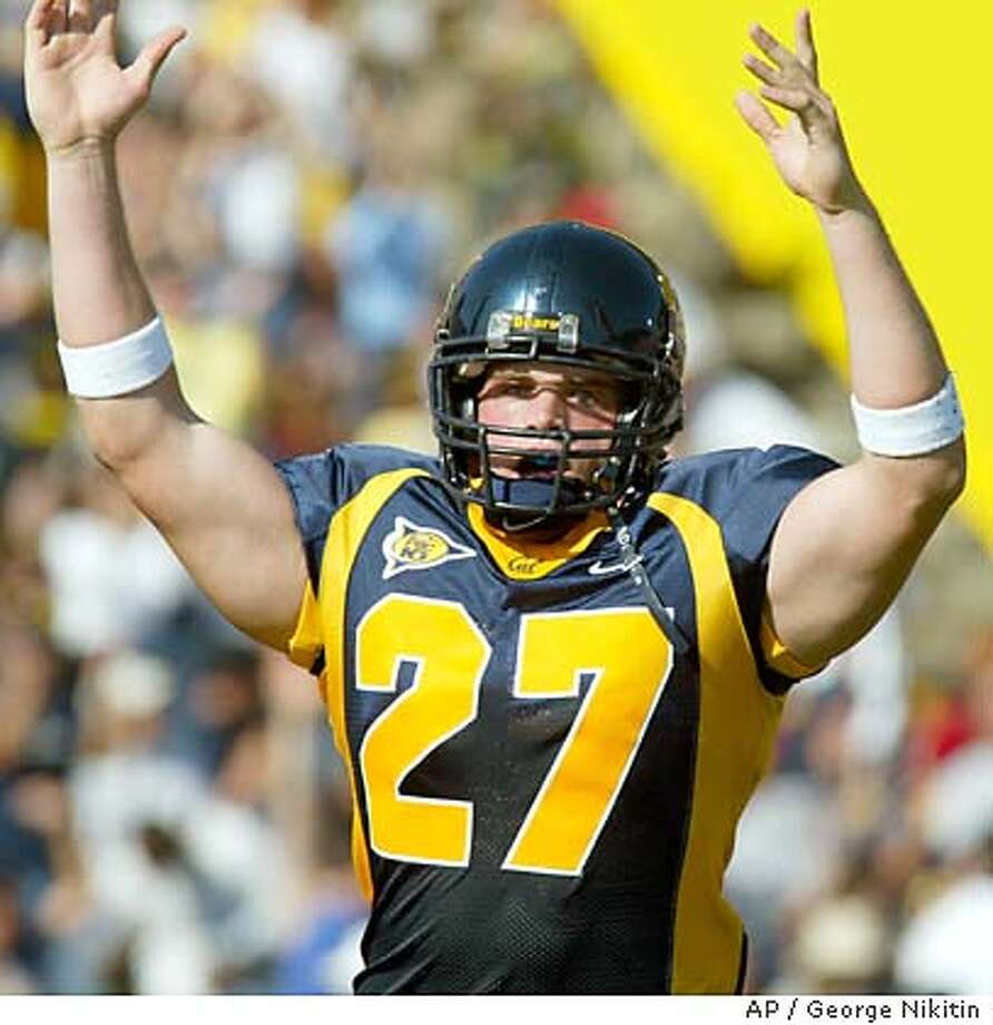 California's Chris Manderino celebrates after the first California touchdown in the first quarter against Southern California, Saturday Sept. 27, 2003, at Memorial Stadium in Berkeley, Calif. Clifornia beat Southern California, 34-31. (AP Photo/George Nikitin) Photo: GEORGE NIKITIN