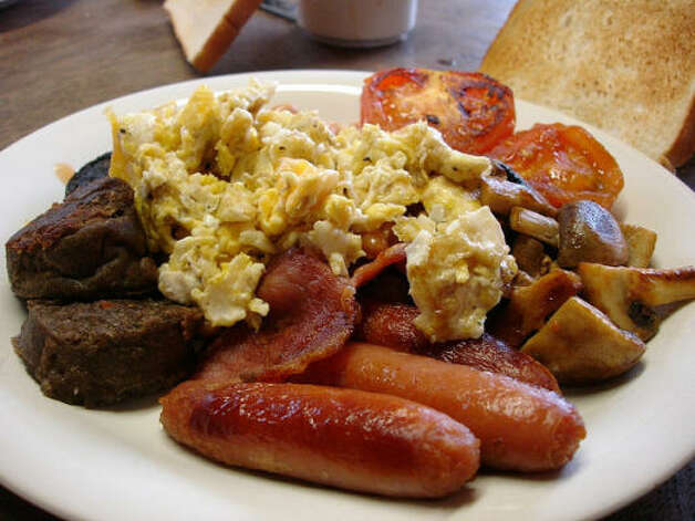 Ireland: A hearty breakfast complete with pudding, eggs, sausage beans and tomatoes. It's a greasy pile of goodness. Photo: Rhodes, Flickr Creative Commons