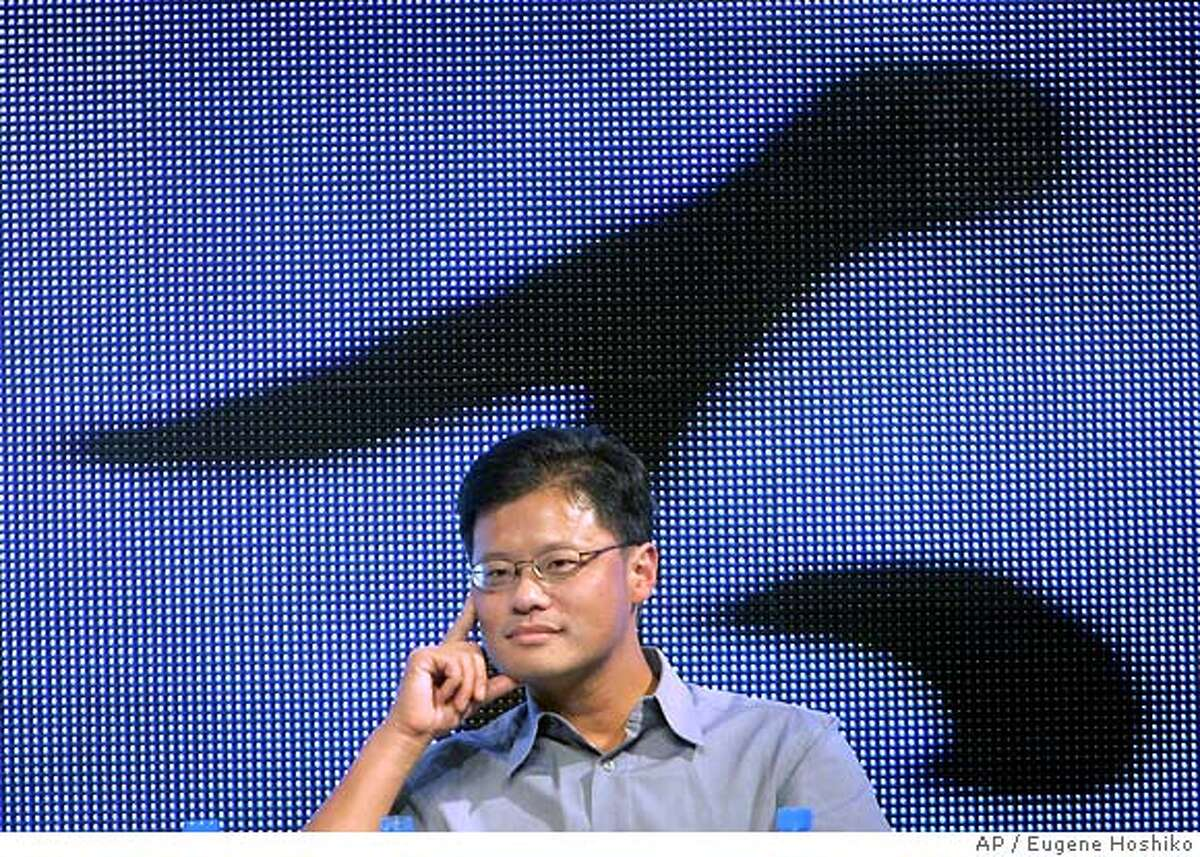 Jerry Yang, co-founder of Yahoo! listens questions from audience at the China Internet Summit Saturday Sept. 10, 2005 in Hangzhou, China. Yahoo had to comply with a demand by Chinese authorities to provide information about a personal e-mail of a journalist who was later convicted under state secrecy laws and sentenced to 10 years in prison, the company's co-founder Jerry Yang said Saturday. (AP Photo/Eugene Hoshiko) Ran on: 09-18-2005 Jerry Yang, co-founder of Yahoo, ac- knowledged giving the Chinese gov- ernment information leading to the arrest of a journalist. Yang says companies must follow Chinese law. Ran on: 09-18-2005 Jerry Yang, co-founder of Yahoo, ac- knowledged giving the Chinese gov- ernment information leading to the arrest of a journalist. Yang says companies must follow Chinese law.