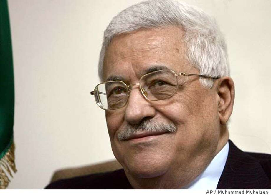 Palestinian President Mahmoud Abbas, also known as Abu Mazen, smiles during a meeting with U.S. Assistant Secretary of State David Welch, unseen, at his office in the West Bank city of Ramallah, Saturday, Feb. 17, 2007. Abbas met with the senior U.S. envoy Saturday, at a time of concern in Washington over Abbas' support for a coalition between the Islamic militant group Hamas and his pragmatic Fatah movement. (AP Photo/Muhammed Muheisen) Photo: MUHAMMED MUHEISEN