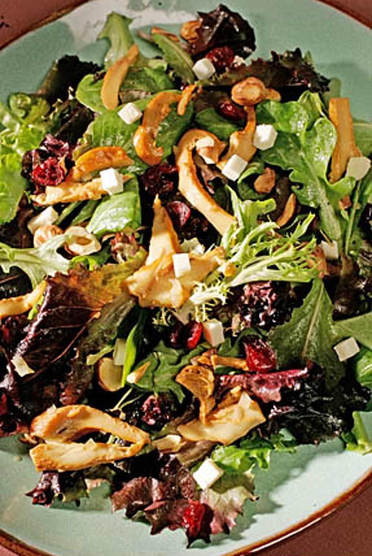 Warm Chanterelle & Goat Cheese Salad With Walnuts And Walnut Oil Using walnut oil and toasted walnuts gives this simple seasonal salad an extra dimension of flavor. Toasted hazelnuts and hazelnut oil can also be substituted, if you prefer. [recipe]