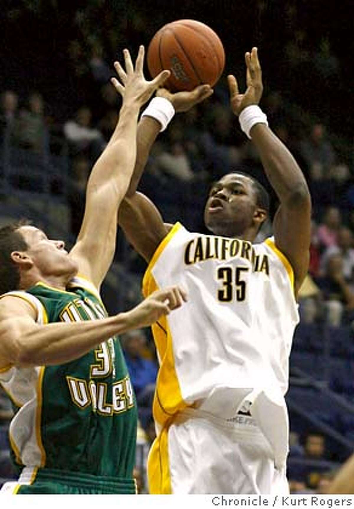 DeVon Hardin with a shot over Jordan Brady in the first half of play the Cal up 29-21 at the half . The California Golden Bears vs Utah Valley State Wolverines At Haas Pavilion . Wednesday, November 15, 2006. KURT ROGERS/THE CHRONICLE BERKELEY THE CHRONICLE SFC