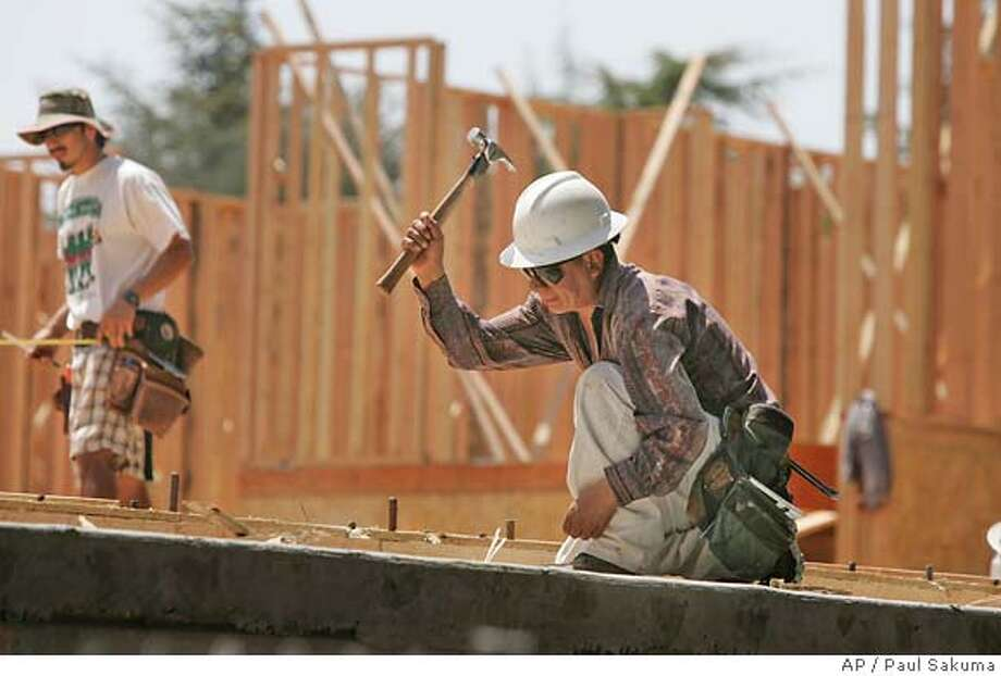 **FILE** Construction workers build a new house in Palo Alto, Calif., in this May 15, 2007 file photo. Employers showed a decent appetite to hire in May, boosting payrolls by 157,000, the most in two months. The unemployment rate held steady at 4.5 percent. The newest report on the nation's overall employment climate, released Friday, June 1, 2007 by the Labor Department, suggested that the sluggish spell the economy has been experiencing hasn't severely crimped companies' need for workers. (AP Photo/Paul Sakuma, file) MAY 15, 2007 FILE PHOTO Photo: Paul Sakuma