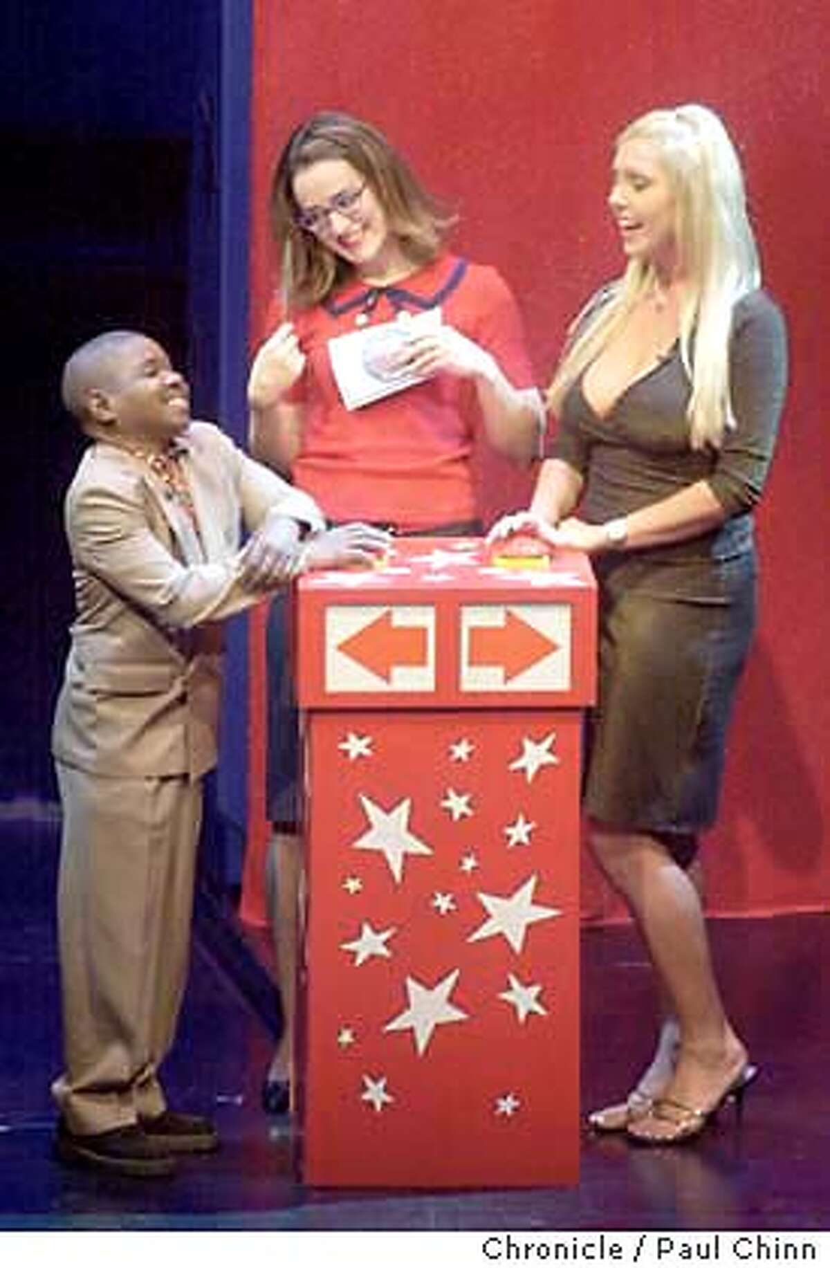 career26287_pc.jpg Gary Coleman flirts with host Kennedy (center) and Mary Carey during the game. The Game Show Network's