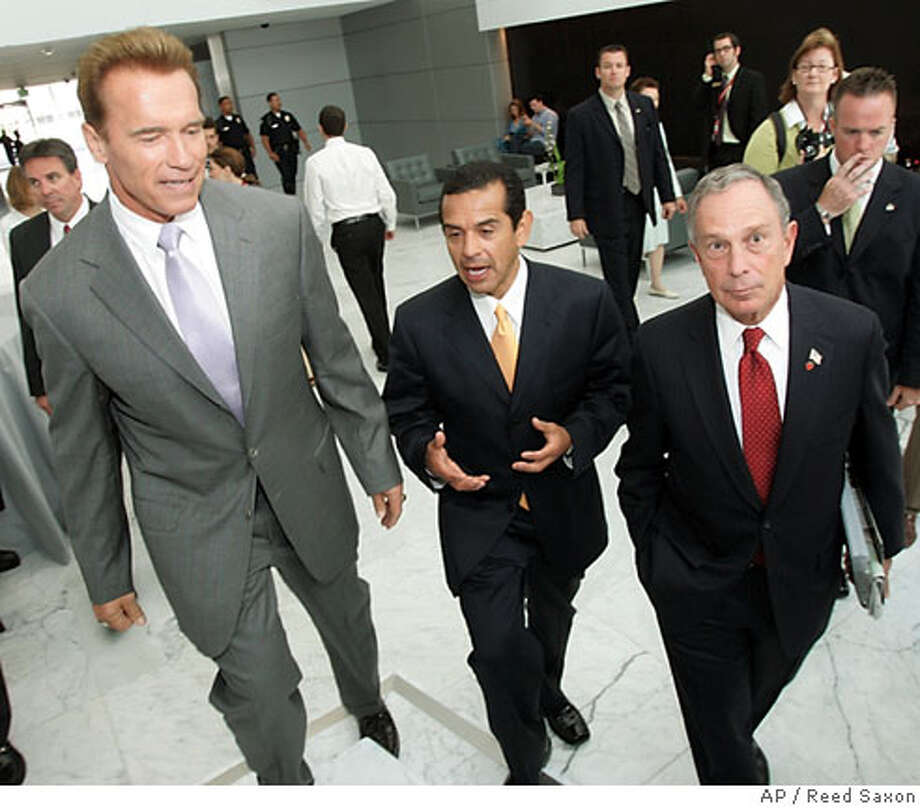 "From left, California Gov. Arnold Schwarzenegger, Los Angeles Mayor Antonio Villaraigosa and New York City Mayor Michael Bloomberg chat at a conference, ""Ceasefire! Bridging the Political Divide,"" focusing on local and state efforts to encourage bipartisanship and support common-sense solutions to the country's most pressing political challenges, in Los Angeles Tuesday, June 19, 2007. The gathering is the inaugural conference of the newly established Center on Communication Leadership at the USC Annenberg School for Communication. (AP Photo/Reed Saxon) Photo: Reed Saxon"
