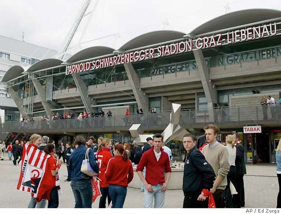 ** FILE ** Soccer fans wait outside the Arnold-Schwarzenegger stadium in Graz, Austria, on Sunday, May 9, 2004, for the start of the national first league soccer match Sturm Graz versus Grazer AK. Authorities late Sunday night or early Monday Dec. 26, 2005, removed the large metal letters spelling out the action star-turned-politician's name from the 15,300-seat stadium in Graz, taking advantage of the Christmas lull to avoid attracting attention. Schwarzenegger had written to the mayor of Graz a week ago asking that his name be removed after local activists called for the stadium to be renamed because of Schwarzenegger's refusal to block the Dec. 13 execution of convicted killer Stanley Tookie Williams in California. (AP Photo/Markus Leodolter) SUNDAY MAY 9, 2004 FILE PHOTO Photo: MARKUS LEODOLTER