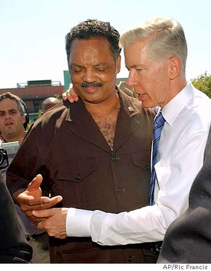 Rev. Jesse Jackson, left, and California governor Gray Davis depart from a news conference Thursday, Sept. 18, 2003, in Los Angeles. They rallied supporters on the campus of Los Angeles Southwest College against the recall election and Proposition 54 which is on the October 7th ballot. Proposition 54, if passed, will prohibit the collection of data on race, ethnicity, color and national origin by California state and local agencies. (AP Photo/Ric Francis) Photo: RIC FRANCIS