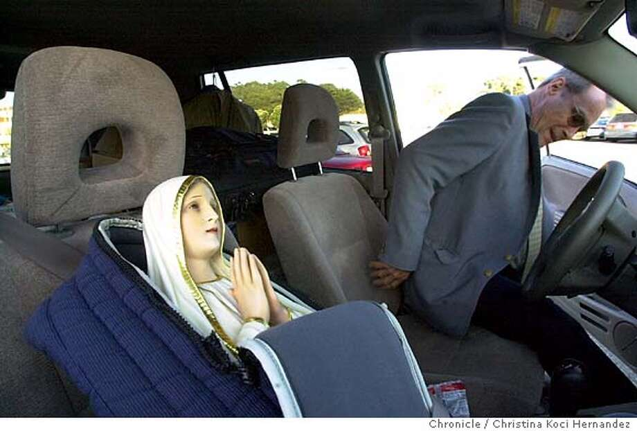 Karl Malburg, the custodian of a 40-inch Our Lady of Fatima statue, buckles the statue into its seat in his van, after taking the statue from St. Boniface Church in San Francisco Ca., on Saturday, September 20, 2003. Malburg brings the statue from church to church for the devoted to see. Photo taken on 9/20/03, in San Francisco, CA.  Christina Koci-Hernandez / The San Francisco Chronicle Photo: Christina Koci-Hernandez
