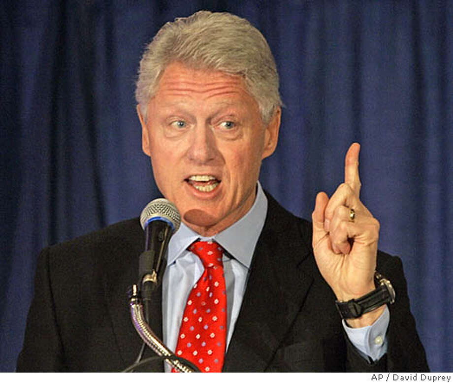 Former President Bill Clinton speaks to Erie County Democrats in Buffalo, N.Y., Wednesday, Dec. 14, 2005. Clinton is planning to attend a Buffalo Sabres hockey game with Sabres owner B. Thomas Golisano after the meeting with Democrats. (AP Photo/David Duprey) Photo: DAVID DUPREY