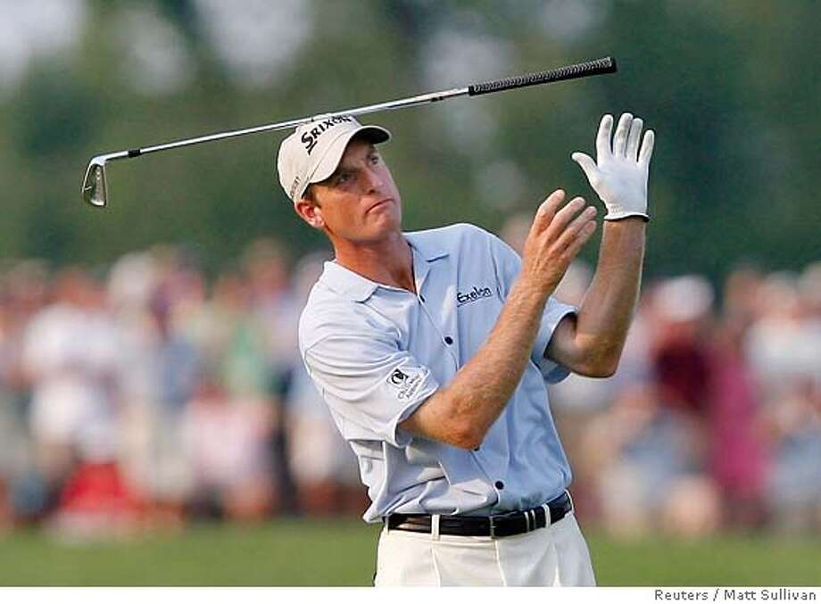 Jim Furyk of the U.S. tosses his club after a shot on the 18th hole during the final round of the 2007 US Open Championship golf tournament at Oakmont Country Club in Oakmont, Pennsylvania, June 17, 2007. REUTERS/Matt Sullivan (UNITED STATES) 0 Photo: MATT SULLIVAN