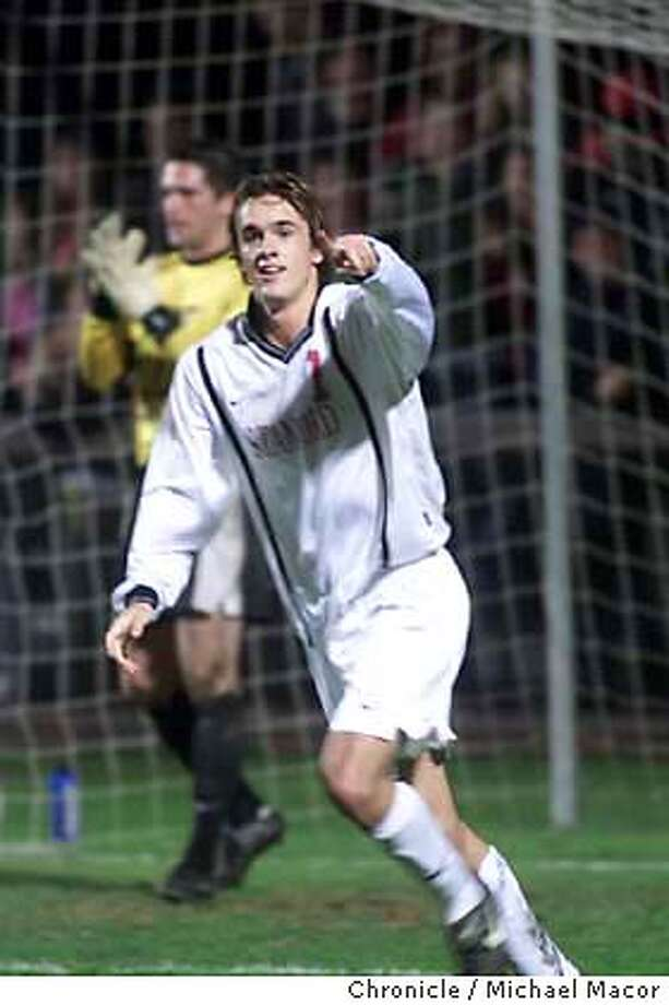 SOCCER08B-C-07DEC01-SP-JC-- Stanford's Roger Levesque points toward his teammates after scoring a goal in the first half on Saint Louis goalkeeper John Politis to give the Cardinal a 1-0 lead as they face the Saint Louis Billikens during their quarterfinals match in the 2001 Divison I Men's Soccer Championship on Friday night at Maloney Field at Stanford. Photo by Jeff Chiu / The Chronicle. Photo: Jeff Chiu