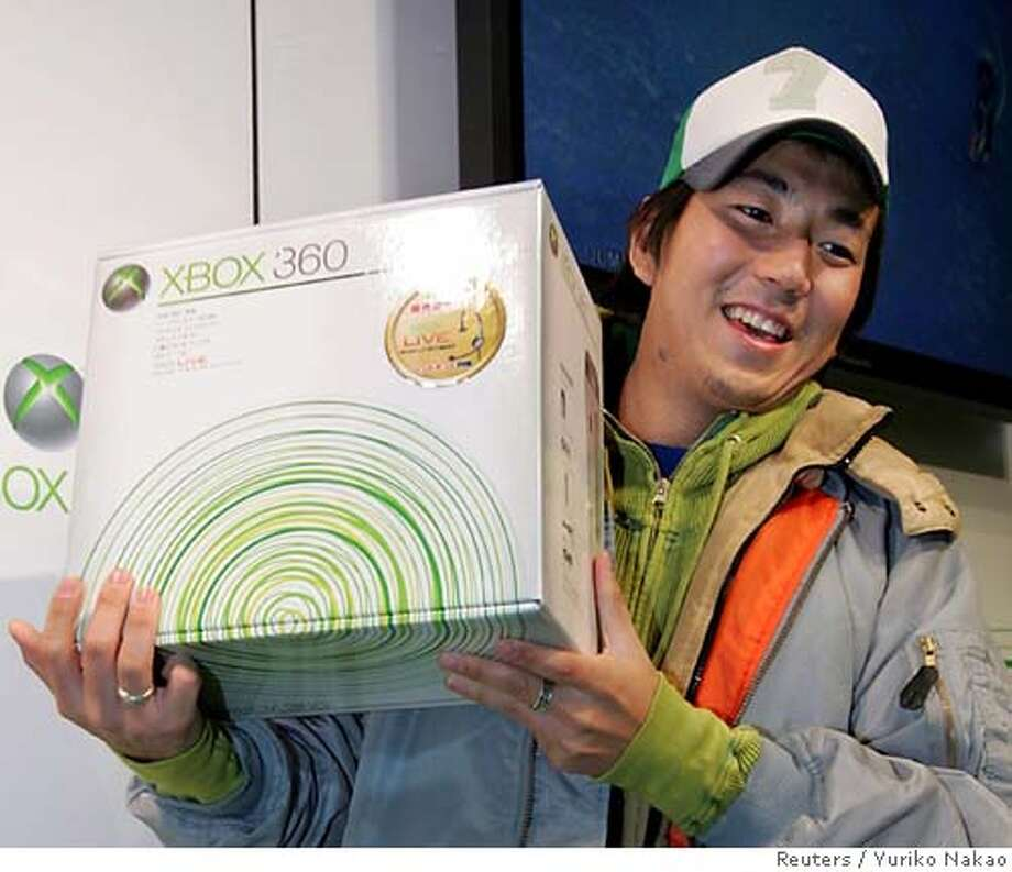 The first customer to buy Microsoft Corp's Xbox 360 video game console at a store smiles as he shows off the product on an early morning in Tokyo December 10, 2005. Xbox 360 is the first next-generation game machine to enter the Japanese market, putting the world's biggest software maker at an advantage versus competitors Sony and Nintendo Co, which plan to launch their latest consoles next year. REUTERS/Yuriko Nakao Ran on: 12-13-2005  Ryan Shaw, 11, hugs his new Xbox 360, which he got at Best Buy in Pearland, Texas, in November. The $399 game console is in such short supply, it's selling on eBay for more than $1,000. Ran on: 12-26-2005  The first customer to buy Microsoft Corp.'s Xbox 360 at a store proudly displays it early on the morning of Dec. 10 in Tokyo. Photo: YURIKO NAKAO