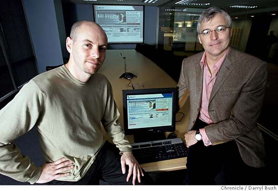NetSuite's Evan Goldberg CTO and chairman, left, and Zach Nelson, CEO, with the companies home page displayed on the computer projection system in NetSuite offices. Event on 12/21/05 in San Francisco.  Darryl Bush / The Chronicle Photo: Darryl Bush
