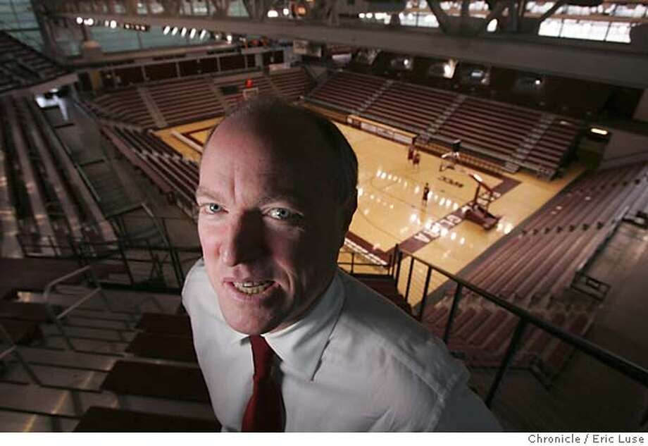 santaclara_coonan_026_el.JPG  Just outside his office Coonan looks over the basketball gym with players practicing over Christmas break.  Dan Coonan is in his 16th month as Santa Clara athletic director. He used to oversee the football program at Cal, now he's at a nonfootball school that's scored some impressive victories -- most recently the women's volleyball team made the NCAA final four. We do a feature on him, focusing on his challenges at Santa Clara, like improving the men's basketball program.Photographer:� Eric Luse / The Chronicle Photo: Eric Luse