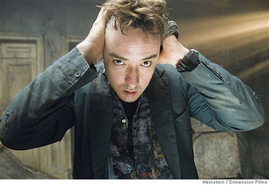 """John Cusack in """"1408""""  Ran on: 06-17-2007  John Cusack is a novelist having a bad experience in a haunted hotel room in &quo;1408.&quo; Photo: Dimension Films 2007"""