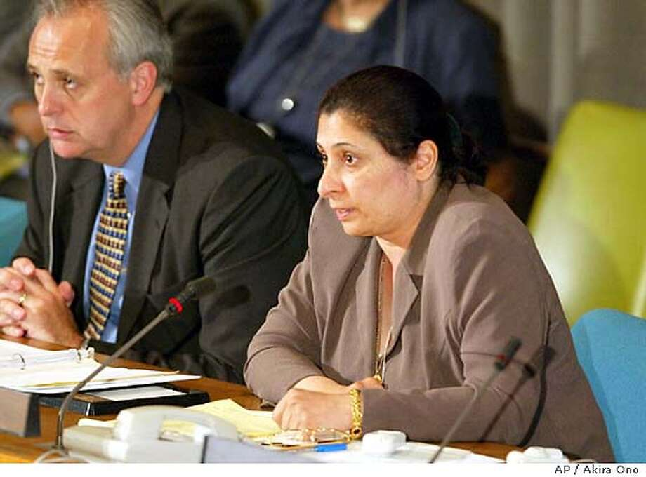 ** FILE ** Iraq's Governing Council member Aquila al-Hashimi is seen in this June 24, 2003 file photo speaking to the United Nations Trusteeship Council meeting on Iraq Reconstruction at the United Nations. al-Hashimi, who was shot Saturday Sept. 20, 2003 in an assassination attempt in Baghdad, died of her injuries Thursday, Sept. 25, 2003. (AP Photo/Akira Ono) Photo: AKIRA ONO
