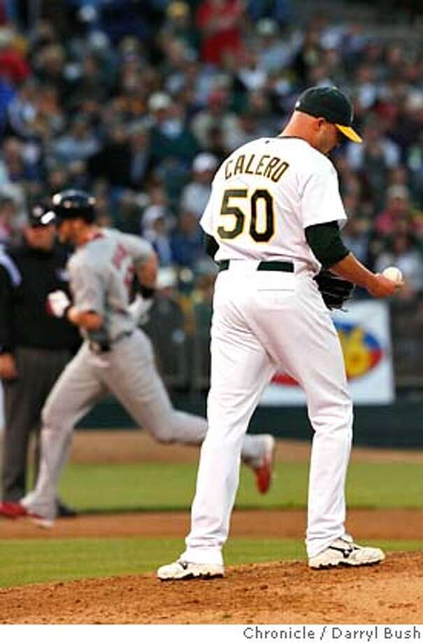 athletics_0008_db.JPG  Oakland Athletics' pitcher Kiko Calero walks back to the mound as St. Louis Cardinals' Chris Duncan rounds the bases after hitting a grand slam off Calero in the 5th inning, Oakland Athletics vs. St. Louis Cardinals at McAfee Coliseum in Oakland, CA, on Saturday, June, 16, 2007. photo taken: 6/16/07  Darryl Bush / The Chronicle ** (cq) Photo: Darryl Bush