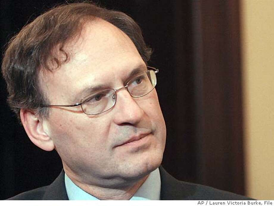 ** FILE ** U.S. Supreme Court nominee Samuel Alito listens to Sen. Johnny Isakson, R-Ga., in this Nov. 18, 2005, file photo in Washington. If President Bush, buffeted by criticism over domestic spying, needs allies on wielding executive authority, he may look no further than his choices for the Supreme Court. Chief Justice John Roberts and nominee Samuel Alito often sided with the government on cases upholding its powers. Roberts backed the president's wartime authority to use a military commission to try terrorist suspects; Alito supported the FBI's reliance on a warrantless video surveillance. (AP Photo/Lauren Victoria Burke, file) Photo: KAUREN VICTORIA BURKE