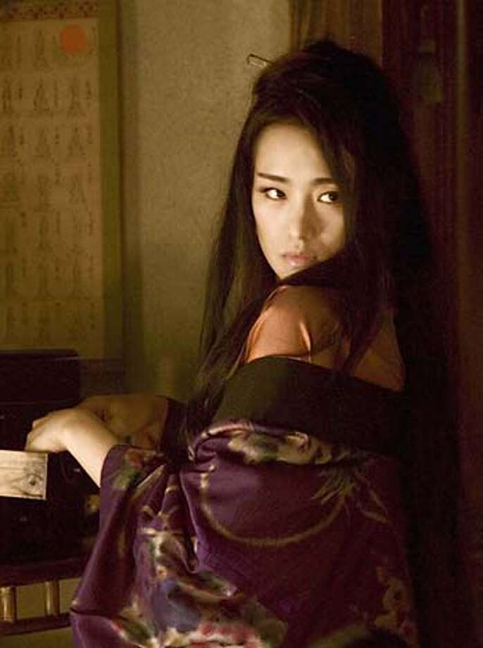 """In this undated handout photo released by Edko Film Co, Mainland China's movie star Gong Li in her movie """"Memoirs of a Geisha."""" A Chinese actress has been accused of evoking humiliating memories of Japanese wartime atrocities in China by portraying a Japanese geisha, an escort trained in dance, singing and conversation, in a Hollywood production. """"Crouching Tiger, Hidden Dragon"""" star Zhang Ziyi has come under attack in China for her starring role in the Steven Spielberg-produced """"Memoirs of a Geisha,"""" the story of a young Japanese girl's rise from poverty to top geisha. Two other ethnic Chinese actresses, Gong Li, and former Bond girl Michelle Yeoh, also play geishas in the movie. ( AP Photo/Edko Film Co., HO) ** NO ARCHIVES EDITORIAL USE ONLY ** NO ARCHIVES EDITORIAL USE ONLY Photo: Edko Film Co."""
